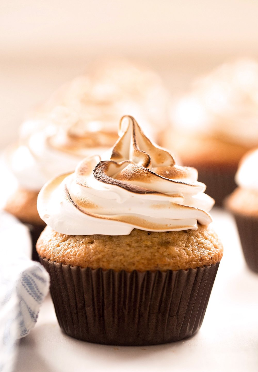 Chai Cupcakes with Meringue Frosting: soft, moist, fluffy cupcakes filled with warm chai spices and topped with a glossy, sweet, marshmallow-like meringue frosting. Dairy-free! | TrufflesandTrends.com