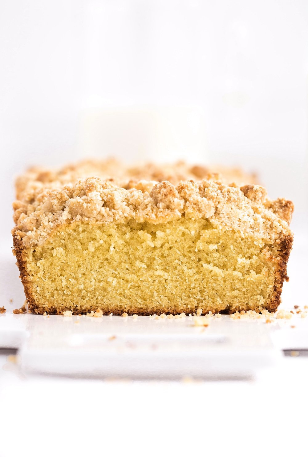 Fluffy Butter Streusel Loaf Cake: this loaf cake is rich and flavorful like a butter cake yet fluffy like a yellow cake. Topped generously with a tasty streusel! | TrufflesandTrends.com