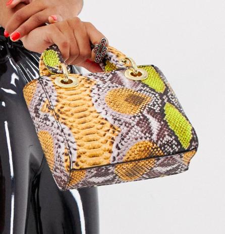 Sacred Hawk bag in mixed snake print