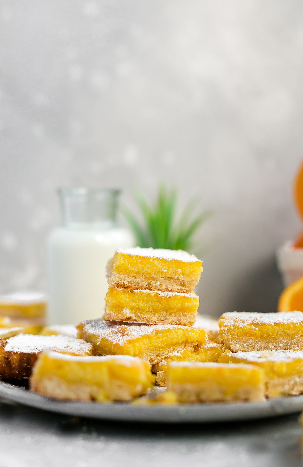 Orange Shortbread Bars: buttery, tender, flaky shortbread crust topped with a silky, rich, tart and sweet orange curd filling. Citrus heaven! | TrufflesandTrends.com