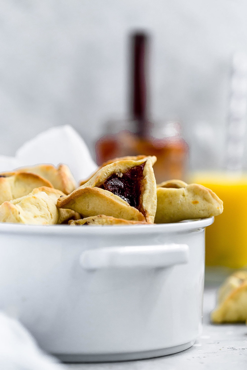 Traditional Hamentashen: soft, melt-in-your-mouth hamentashen cookies with a hint of orange flavor and assorted fillings. Happy Purim! | TrufflesandTrends.com