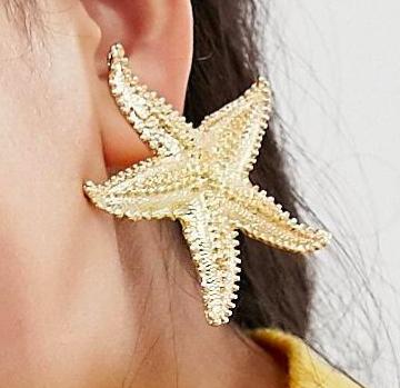 ASOS DESIGN earrings in statement starfish design in gold