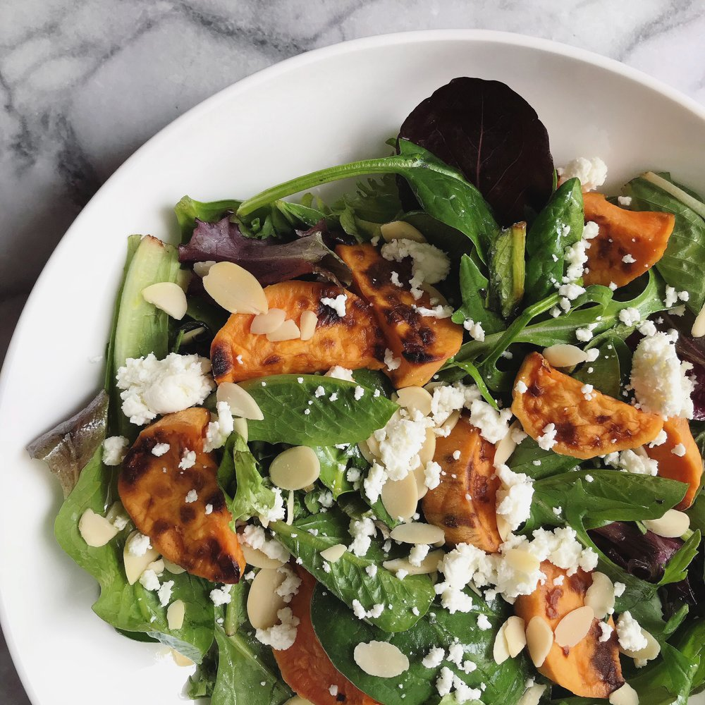 Roasted sweet potatoe and goat cheese salad - 1/2 roasted sweet potato + 2 handfuls of mixed greens + 0.5 ounces of crumbled goat cheese + 0.5 ounces sliced almonds + 1 tbsp. homemade honey mustard (1 tbsp. honey + 2 tbsp. olive oil + 1 tsp. dijon or yellow mustard)