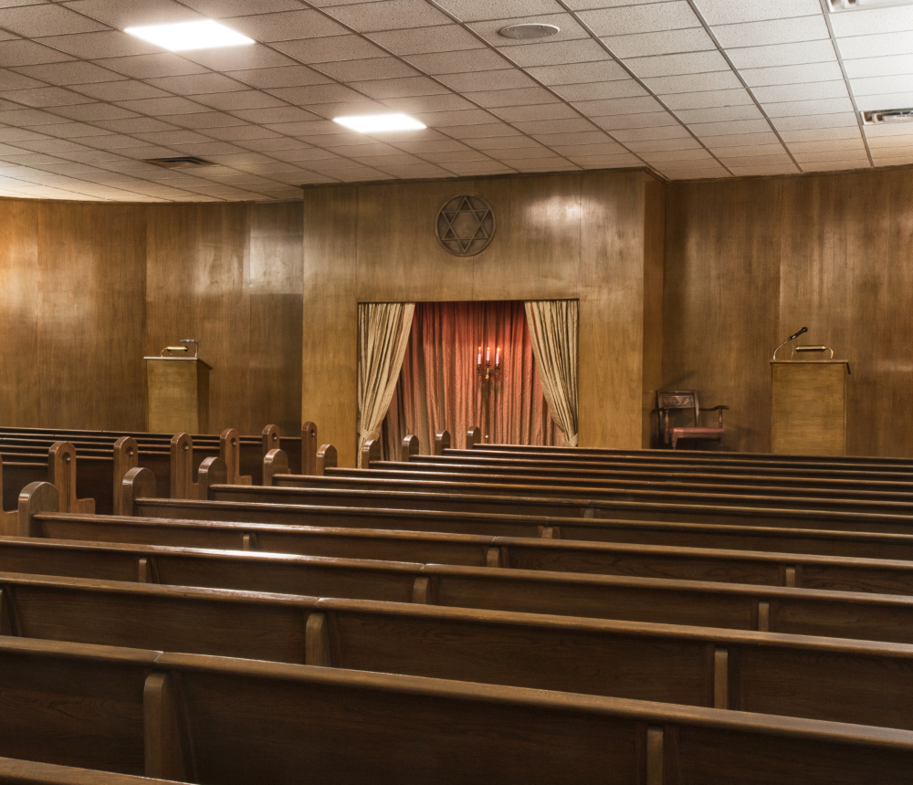One funeral home in Brooklyn is equipped with two handsome sanctuaries where families and friends can gather before a burial. The warm, wood-lined chapel above seats 175 people, is on the second floor, and has elevator access for everyone needing it.