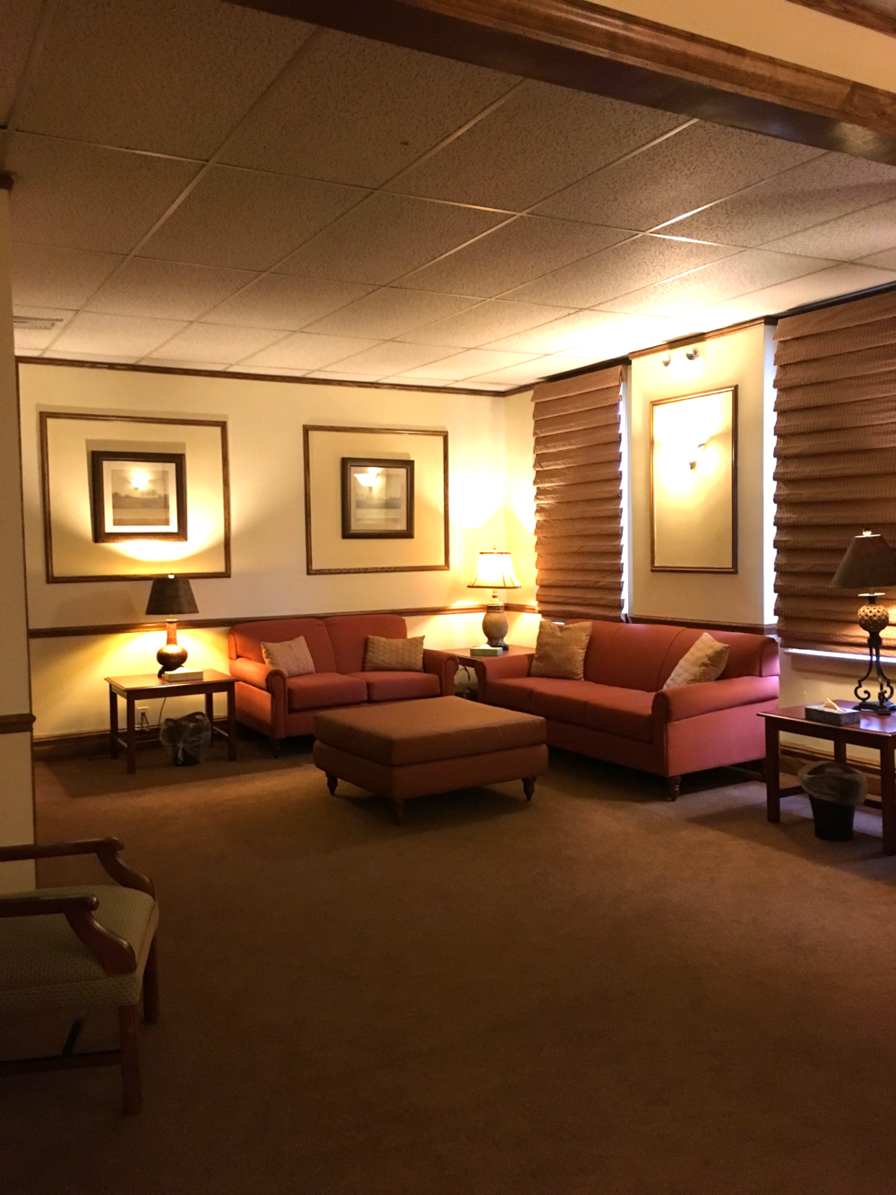 Your family can relax in a family room like this one in a quiet corner of the funeral home before entering the larger chapel, or your entire service could be held in this room if you have a small group. A special alcove to the left holds the open or closed casket.
