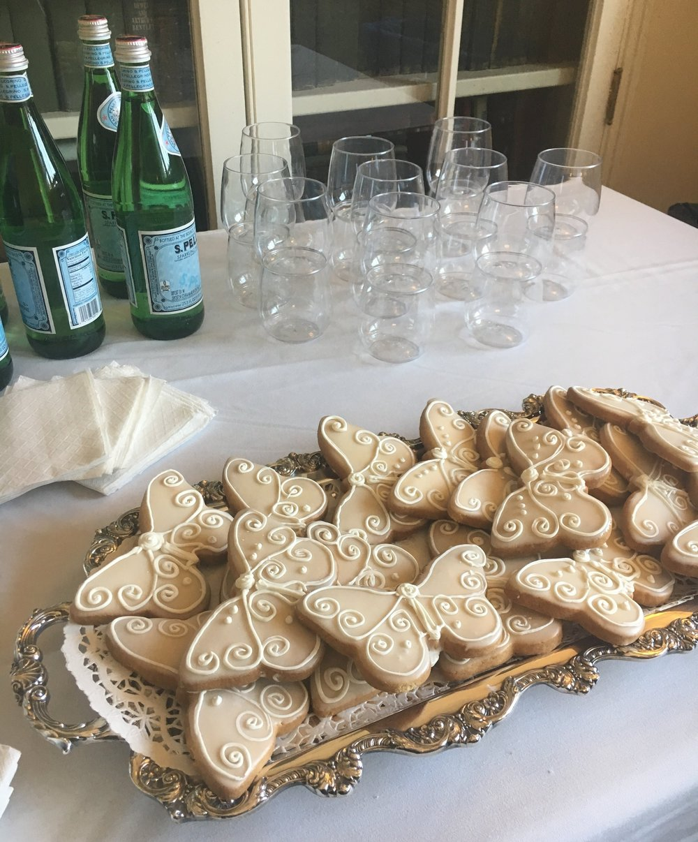 The food doesn't have to be complicated. We're fond of serving sparkling water, tea, coffee and butterfly cookies.