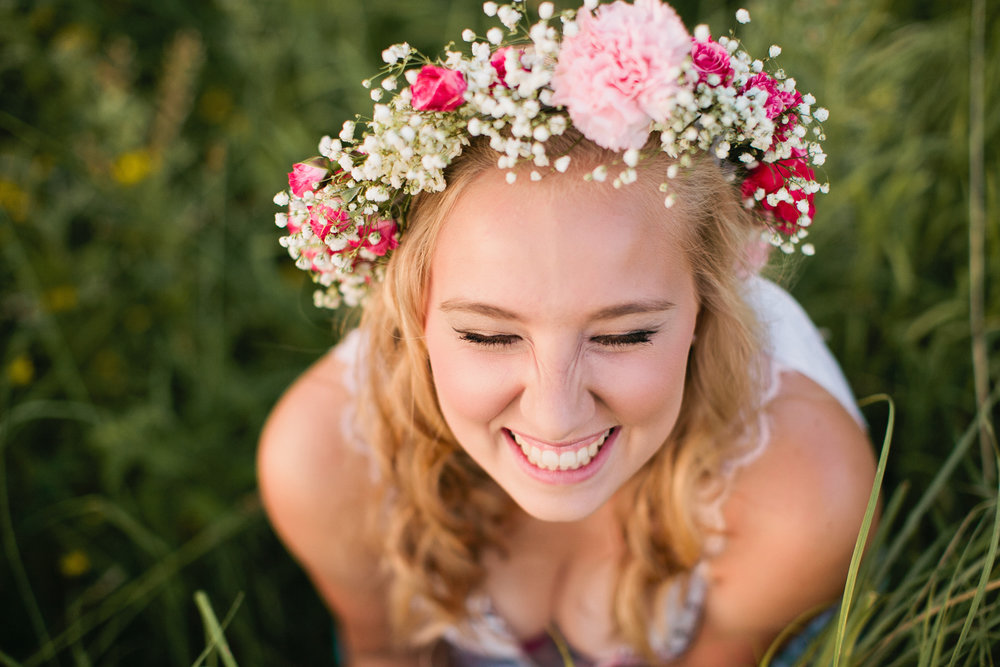 laughing girl with flowers in hair