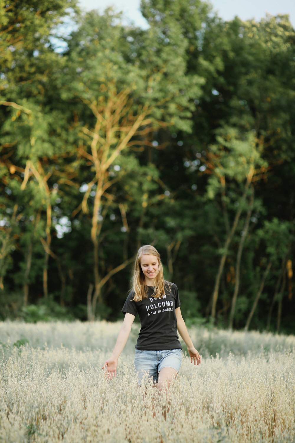 girl walking through wheat fields