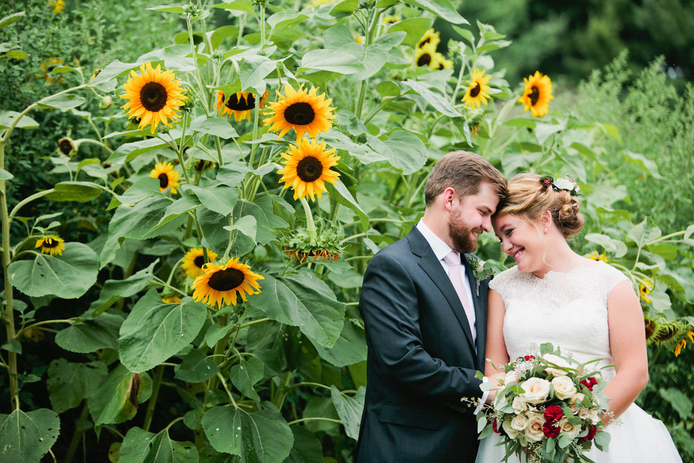 couple with sunflowers on wedding day