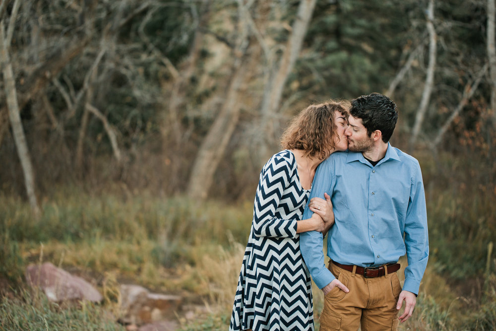 cute couple in fall engagement photos in Colorado Mountains