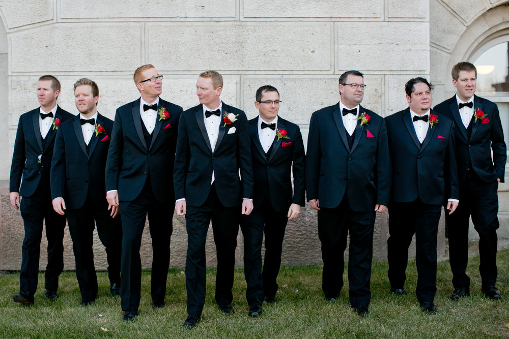 Groomsmen in formal tux and black bow ties December wedding Des Moines Iowa