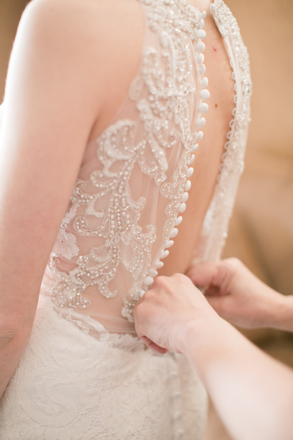 ornate beaded wedding dress with buttons
