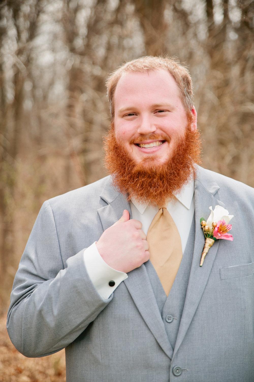 portraits of groom in grey suit