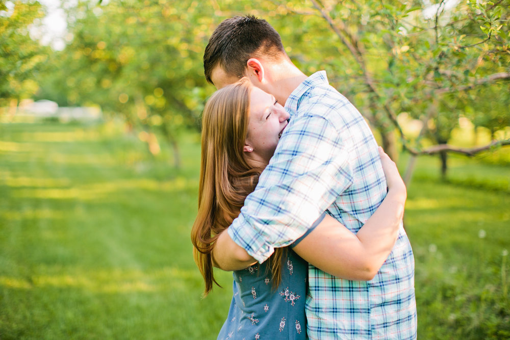 junebug weddings engagement session in apple orchard Iowa