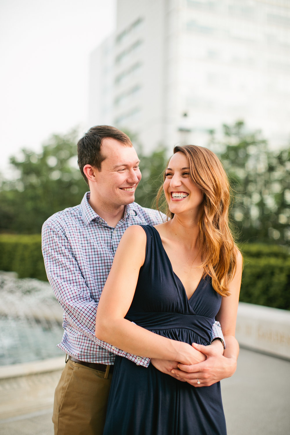 Cedar Rapids engagement photos downtown in front of water fountain