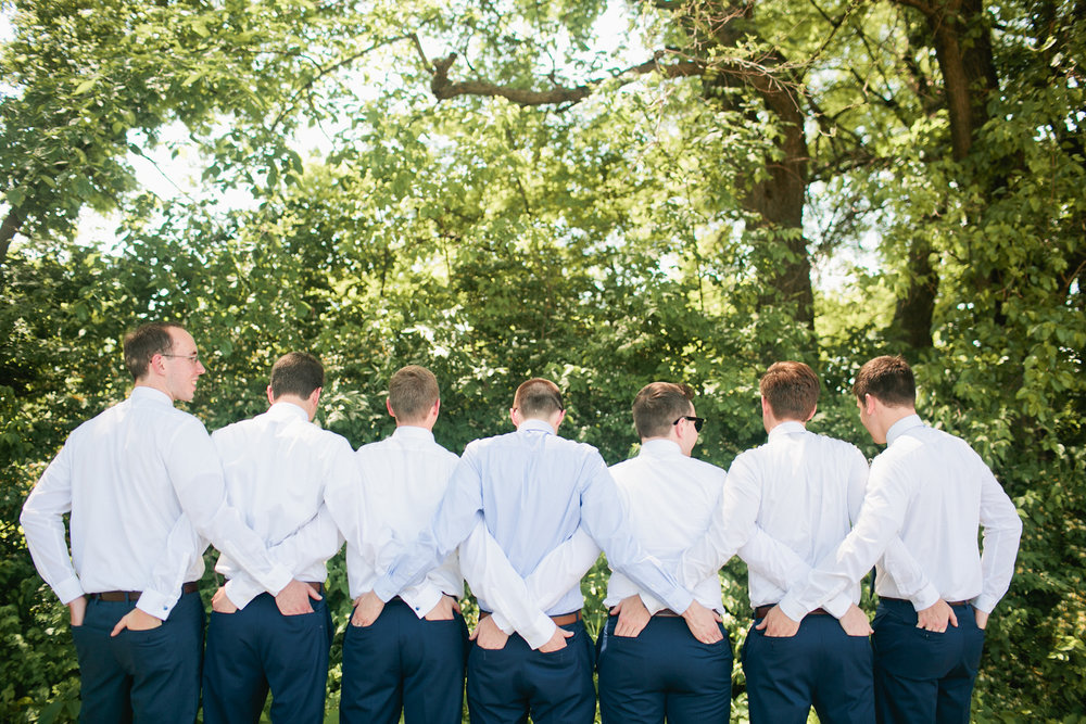 funny photo of groomsmen with hands in each others pockets