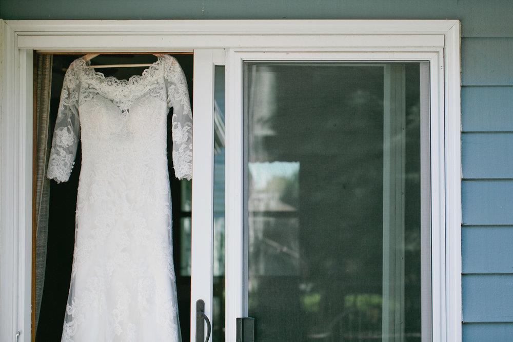 lace wedding dress in house window