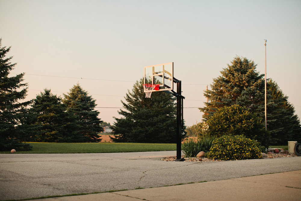 basketball hoop in driveway at country house