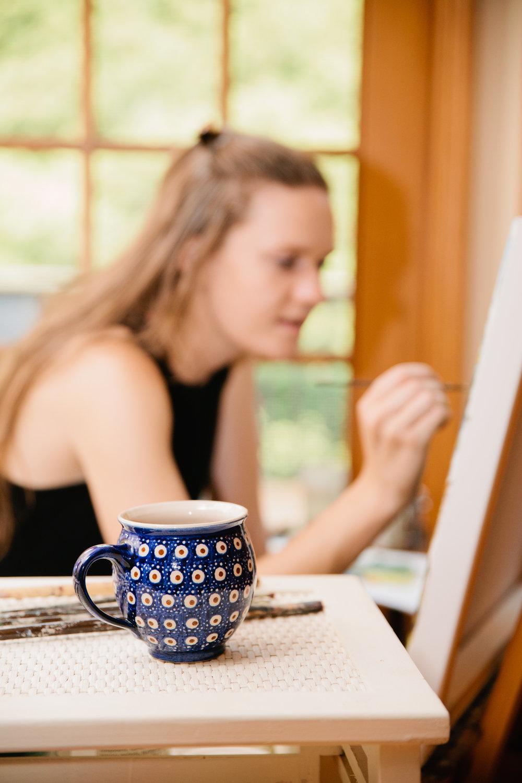 amelia-drinking-tea-and-painting
