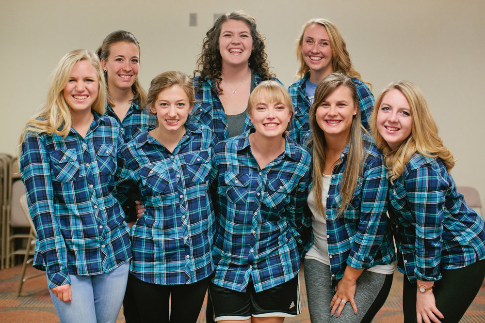 bride and bridesmaids in matching flannels