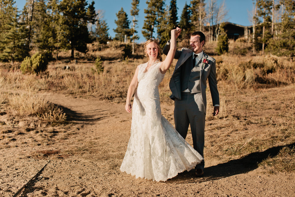 groom twirling the bride in colorado wedding photography
