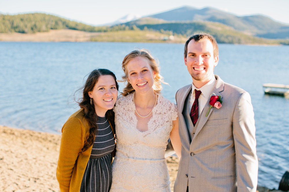 Colorado bride and groom take a photo with photographer Amelia Renee