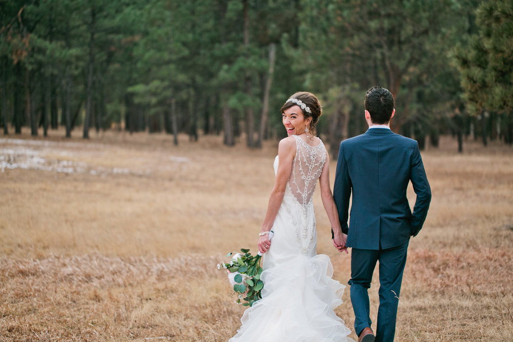 Jan and Grant married out in the woods in Colorado Springs at La Foret Retreat and Conference center in a gorgeous winter wedding. As you can see, the bride is super excited to be married!