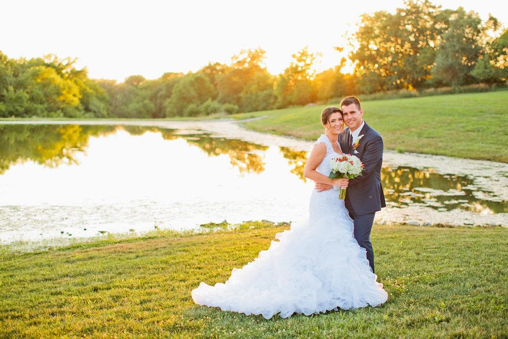 wedding photos by lake at sunset ridge barn des moines