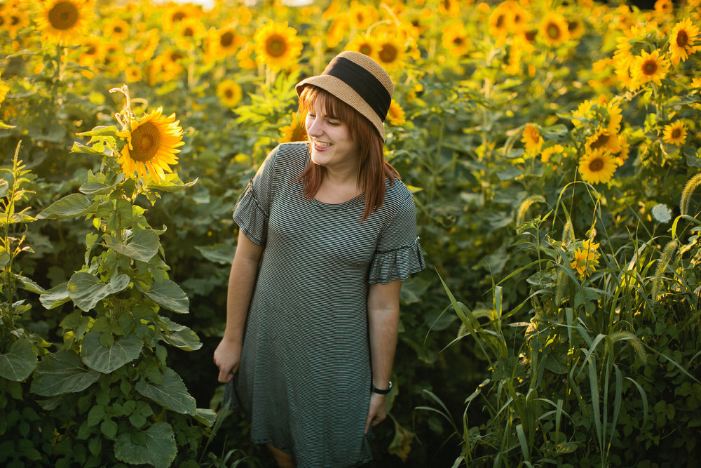 senior girl model in field of sunflowers iowa
