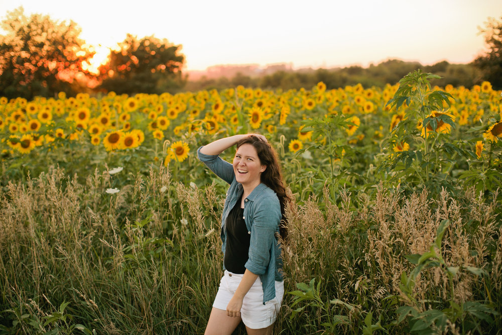 senior model girl in field of sunflowers in altoona Iowa