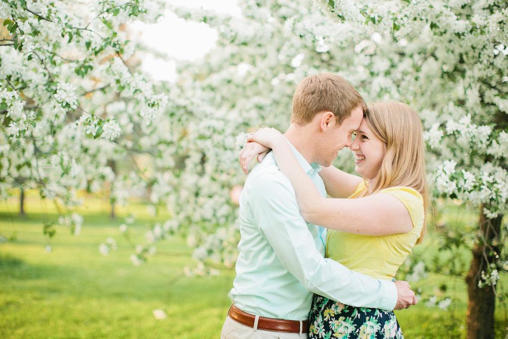 cherry blossoms waterworks park des moines engagement photos blonde couple