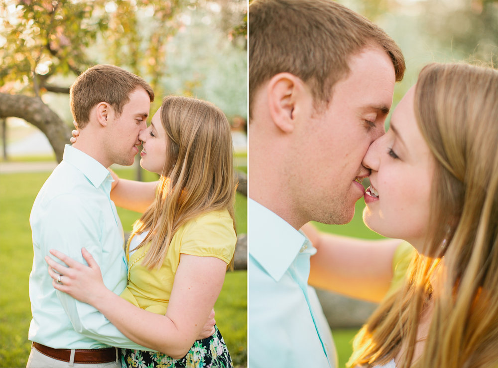 couple kissing engagement photos Des Moines in spring flower cherry blossoms