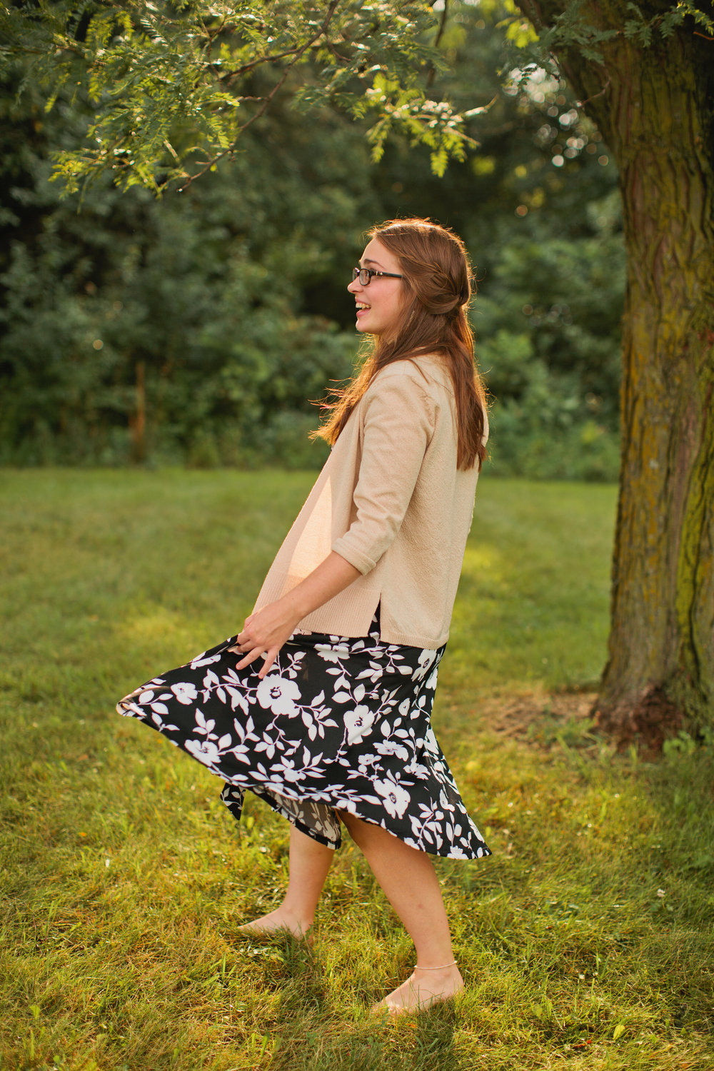 senior girl dancing in dress and cardigan senior photos Iowa