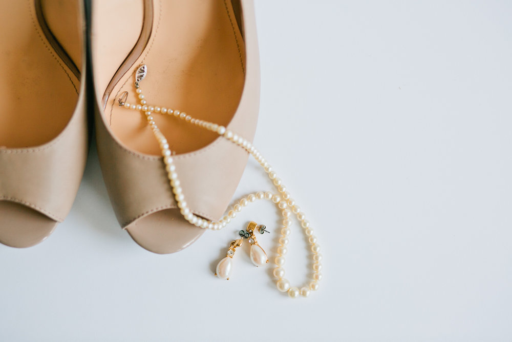 bridal shoes and pear necklace with pearl earrings