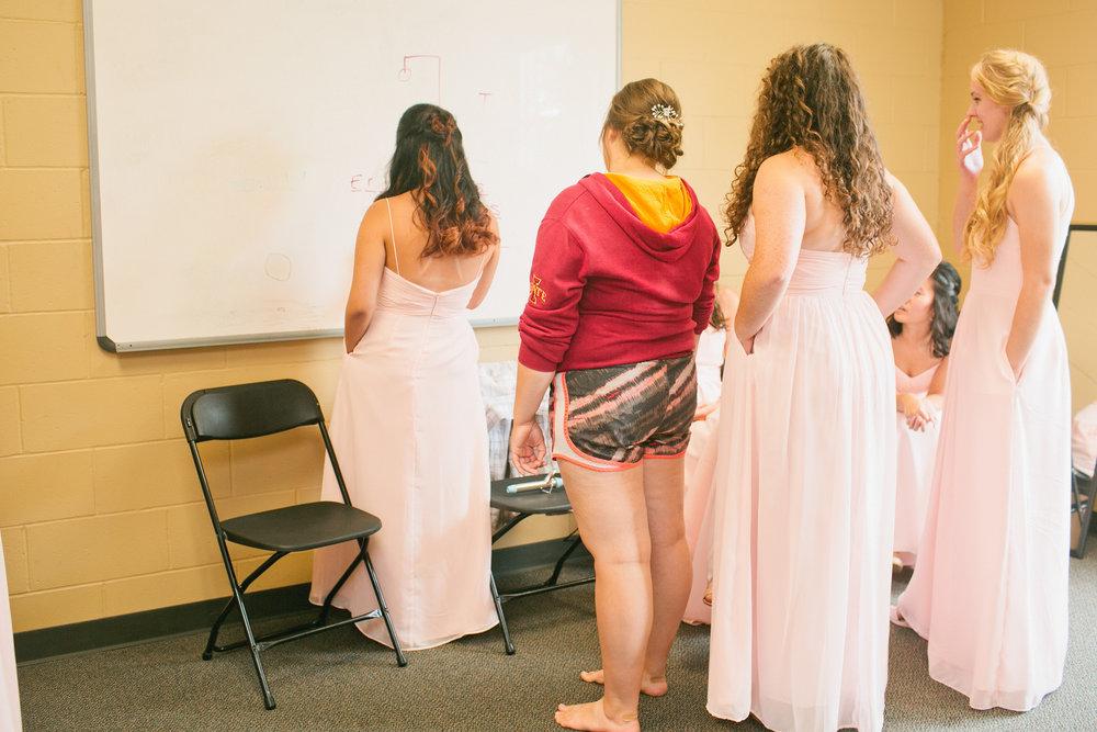 bride and bridesmaids playing hangman