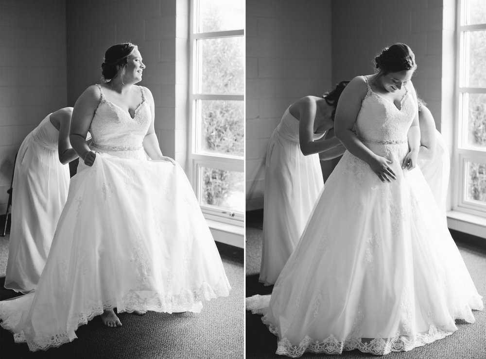 des moines wedding photographers // bride getting zipped into dress black and white