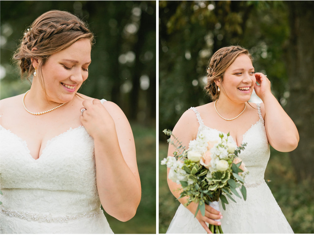 gorgeous bride with braid in hair and roses