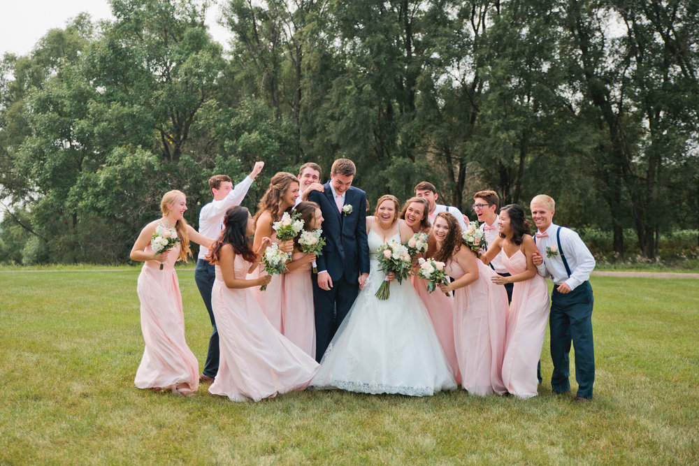 bridal party storming the bride and groom