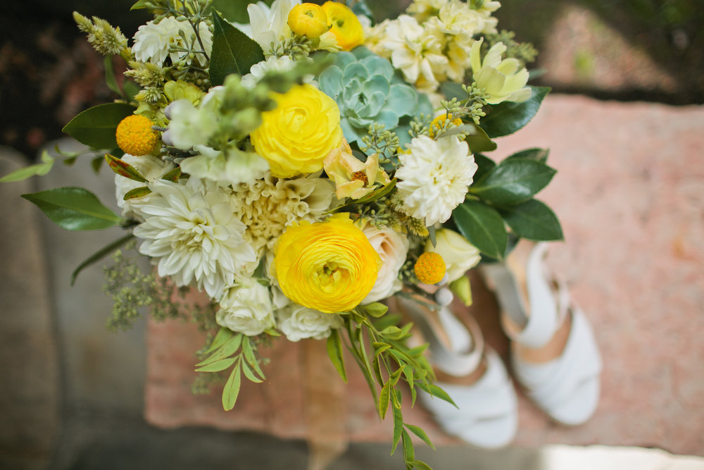 yellow and green and white wedding flower bouquet