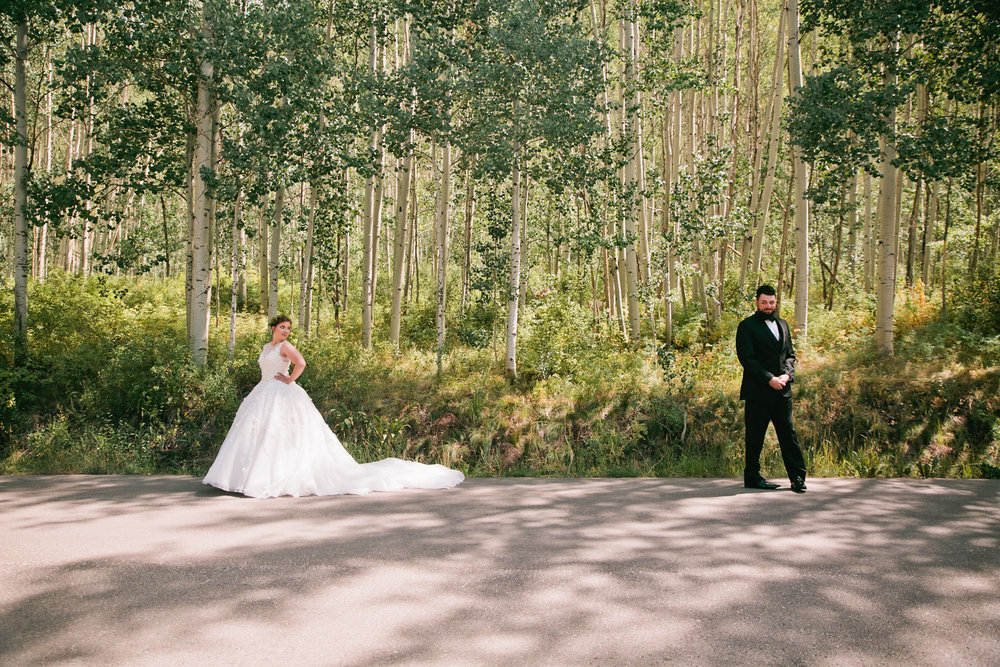 first look in the mountains of Vail, Colorado // bride and groom // wedding venues in Colorado