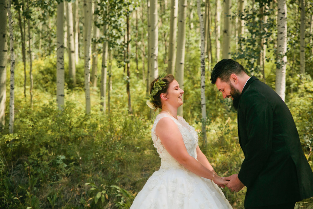 romantic and emotional first look between bride and groom in Colorado Mountain Wedding