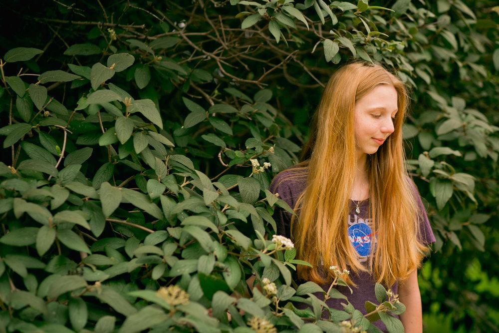 kelly senior girl redhead on UNI campus