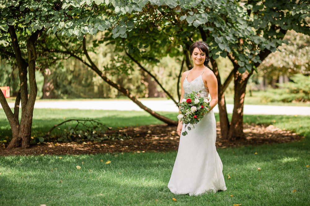 bride holding her bouquet on central campus in Ames Iowa