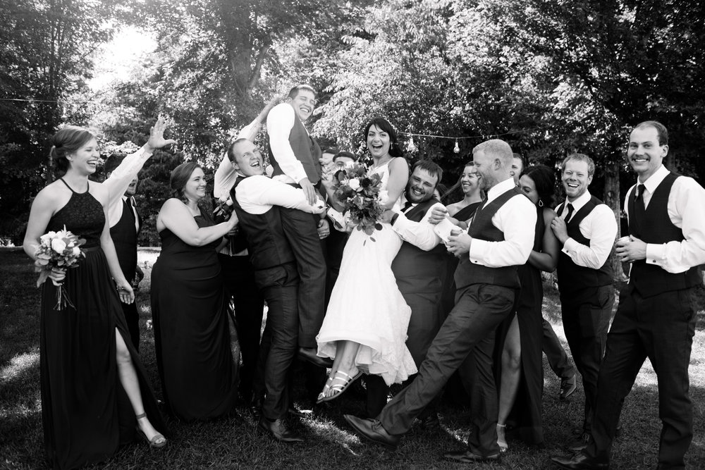 bridal party attacking bride and groom picking them up