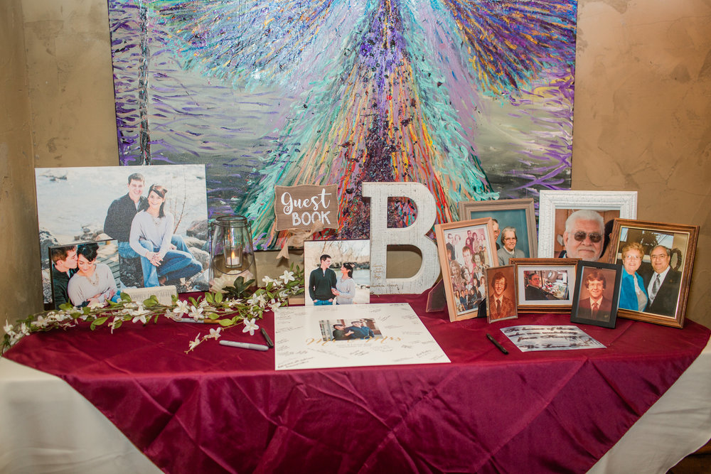 bride and groom guestbook ideas at wedding with photos of grandparents