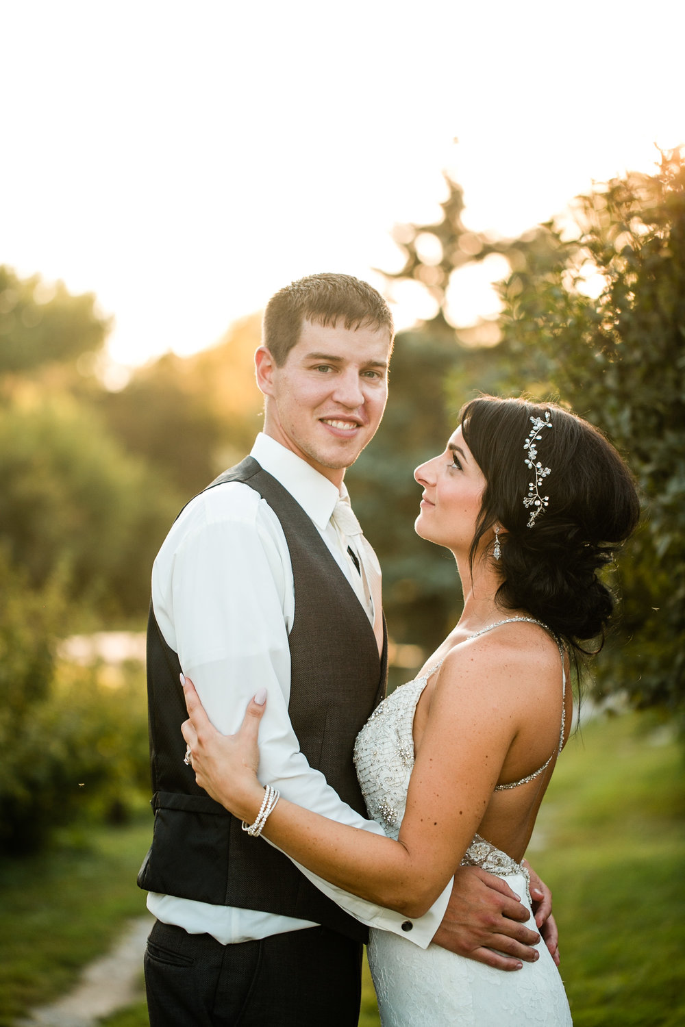 bride and groom wedding photos outside at sunset