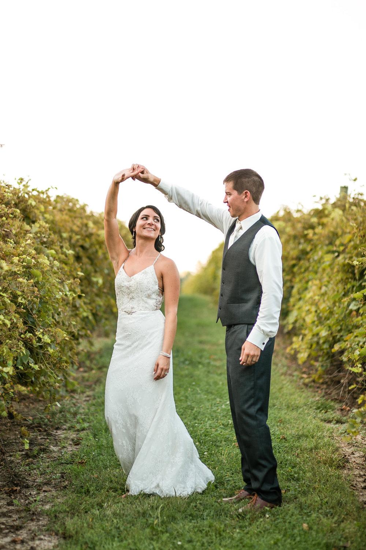 bride-groom-dancing-sunset-vineyard