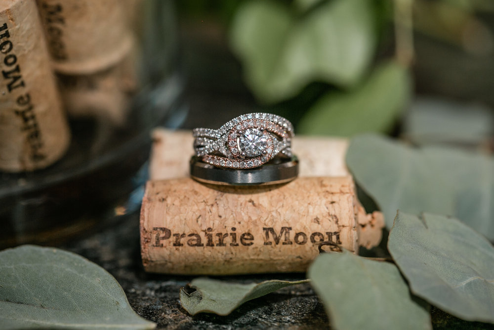 wedding rings on vineyard cork with eucalyptus leaves
