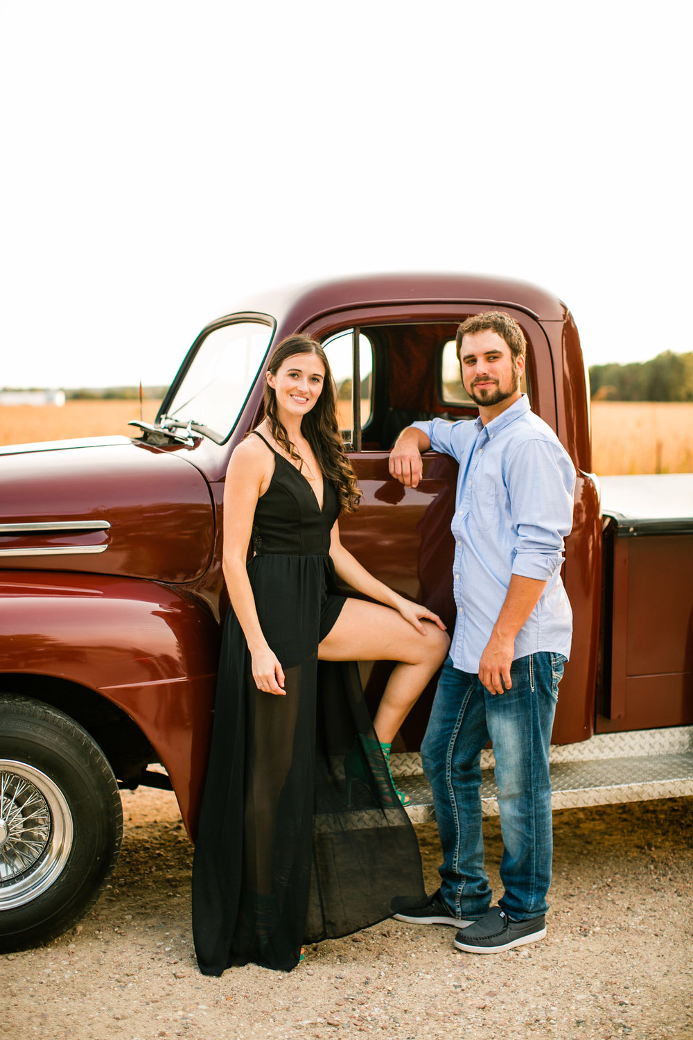 vintage truck engagement photos long black dress green wedding shoes styled Iowa