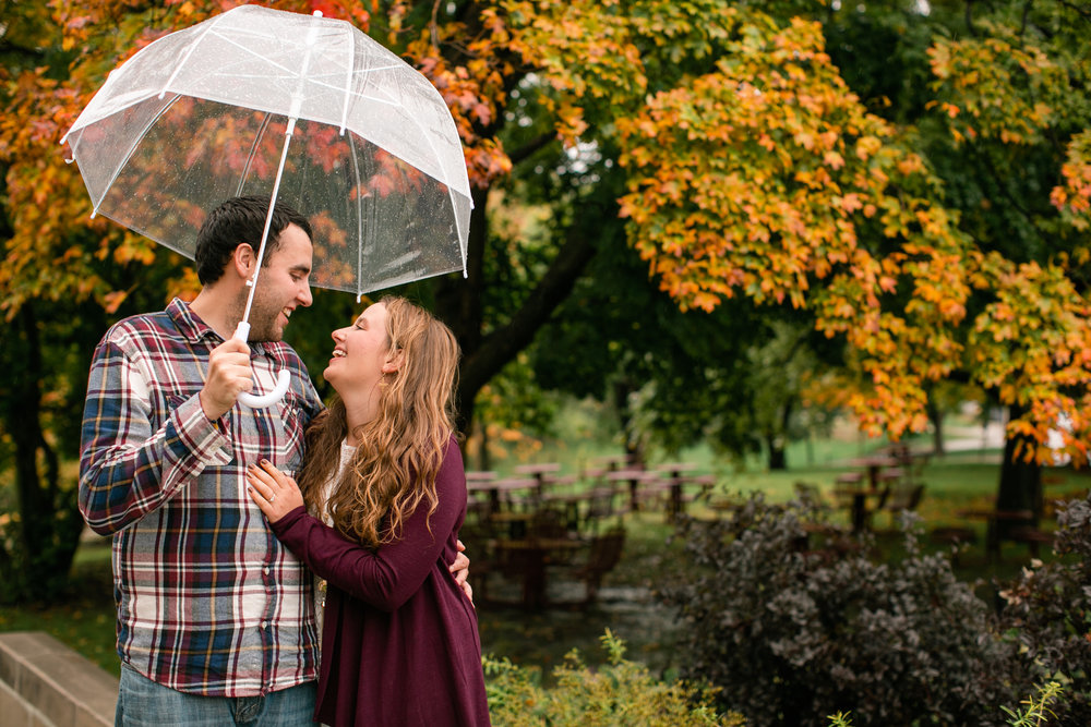 fall engagement photos in Ames Iowa with clear umbrella